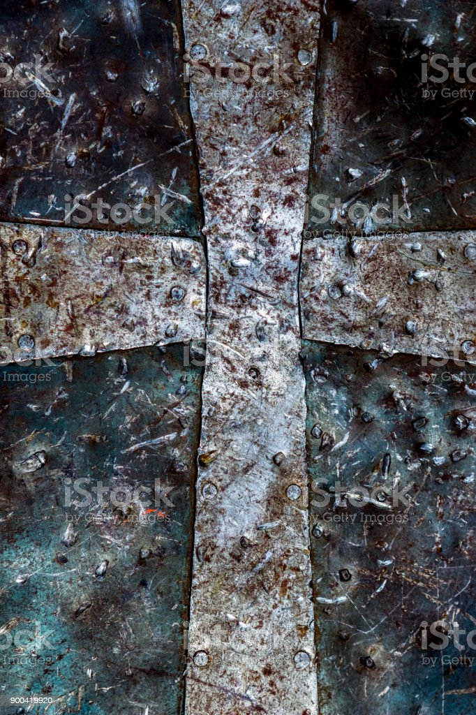 Detailed Closeup Photo Of A Christian Cross Symbol On A Rusty
