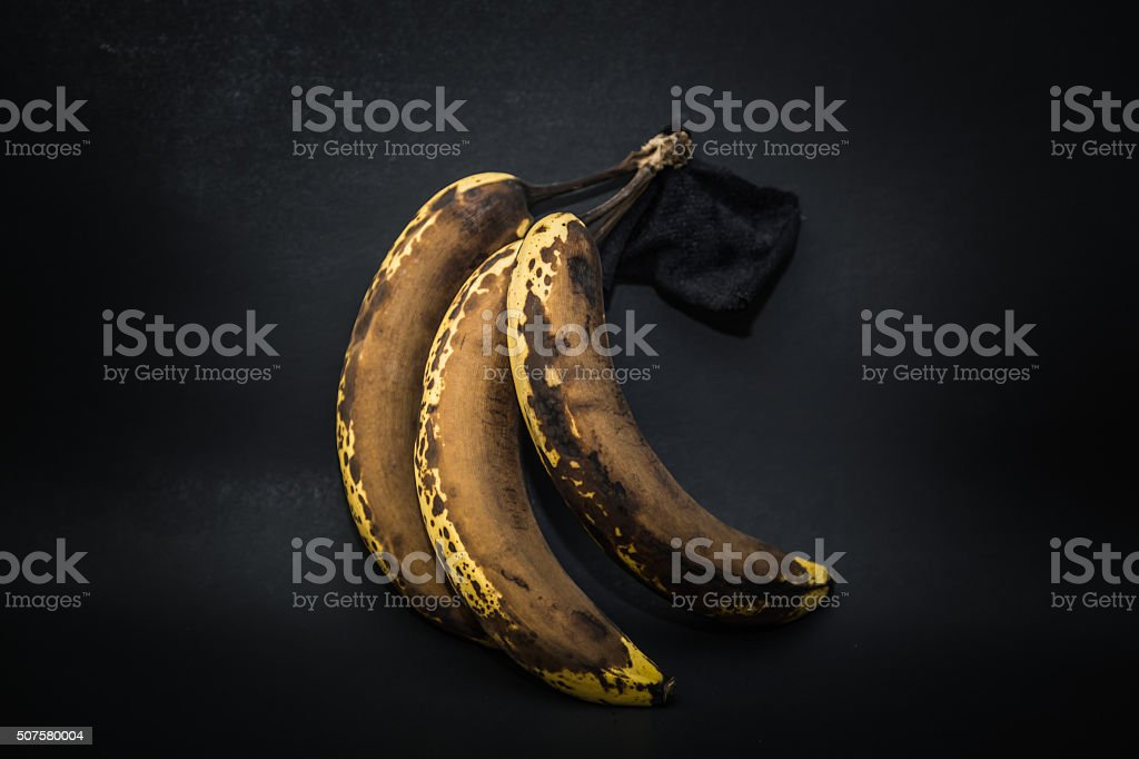 Detailed closeup view of old stained expired banana fruits stock photo