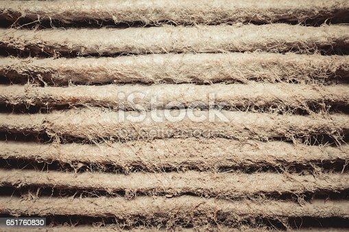 istock Detailed fragment of dirty air filter surface. 651760830