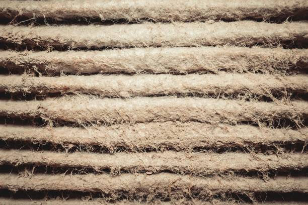 Detailed fragment of dirty air filter surface. stock photo