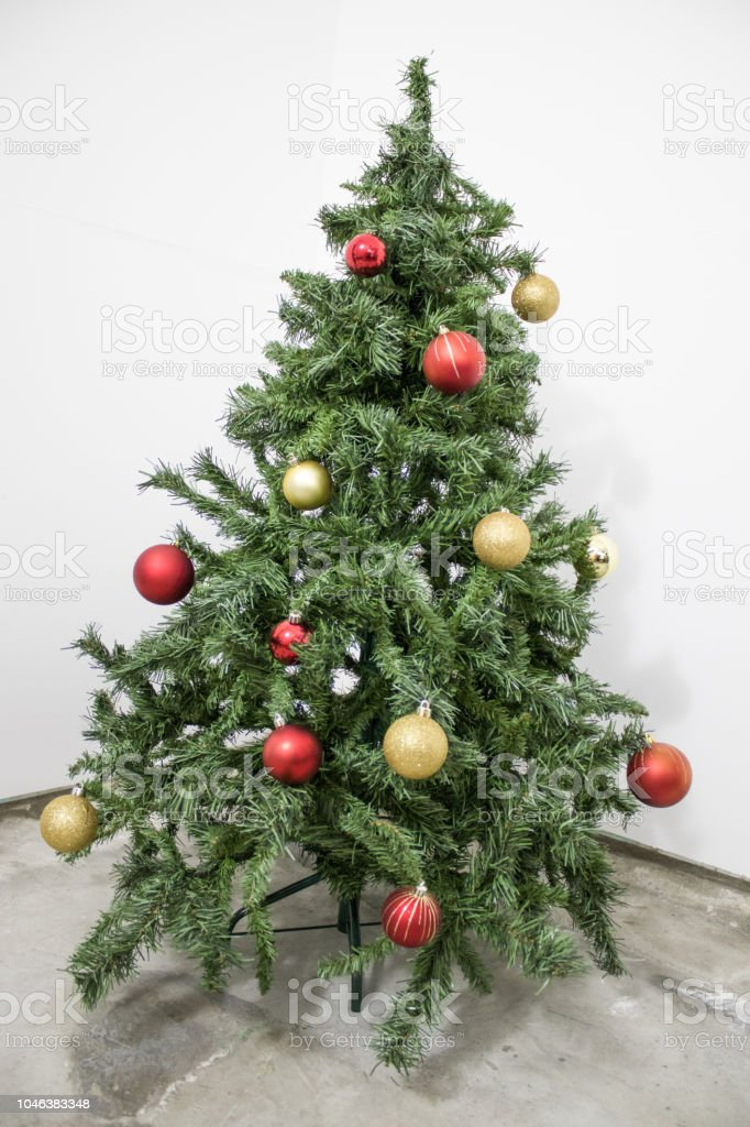 Detailed Green Christmas Tree With Red And Gold Decorations In A White Background Composition Stock Photo Download Image Now Istock