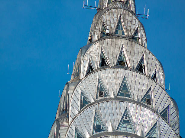 detailed mosaic work on chrysler building against the sky - chrysler building stock photos and pictures