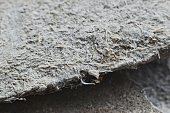 Detailed photography of roof covering material with asbestos fibres.