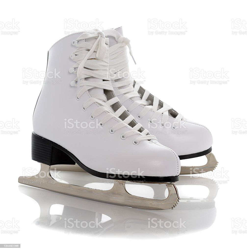 Detailed shot of figure skates against white background royalty-free stock photo