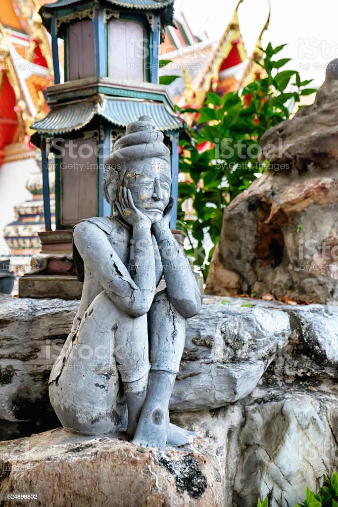 Detailed statue  in Wat Pho, Buddhist temple, Bangkok, Thailand. stock photo