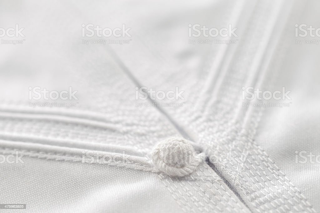 Detailed stitching of Kandura, the ankle-length garment stock photo