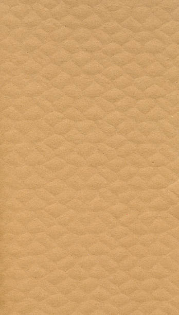 Detailed texture of light brown thick corrugated cardboard stock photo