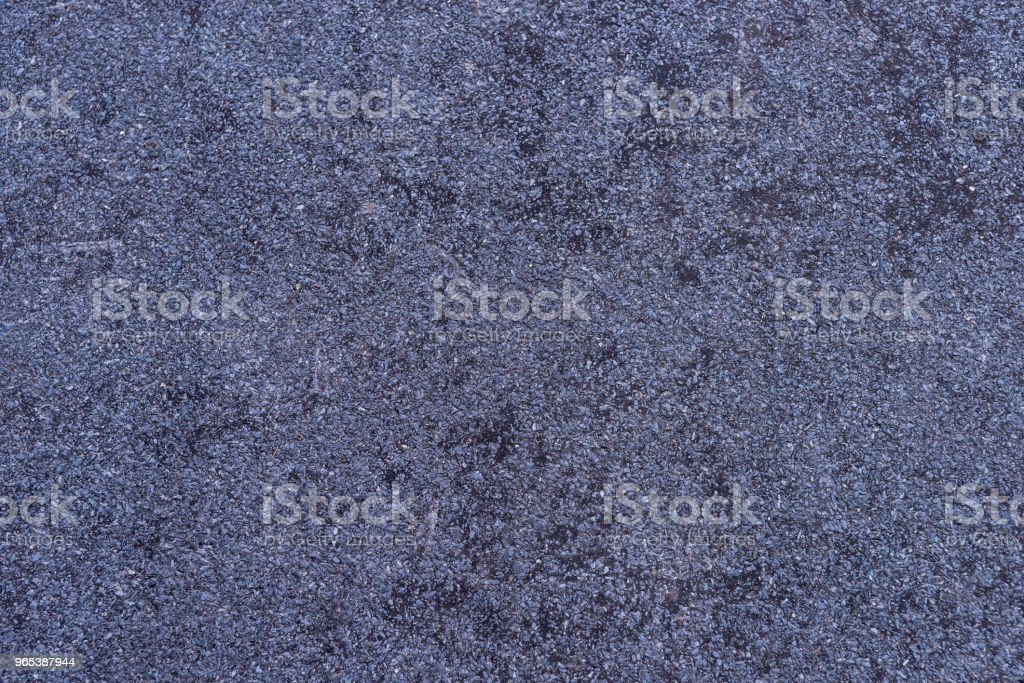 Detailed texture of purple granite wall zbiór zdjęć royalty-free
