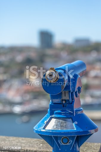 Oporto/Portugal - 10/02/2018 :Detailed view of a public blue monocle, blurred city and blue sky as background