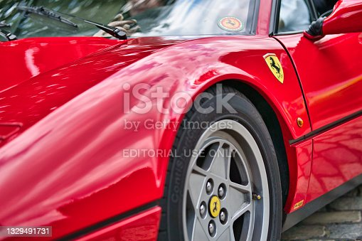 istock Detailed view of old red ferrari parked in Hamburg, Germany 1329491731