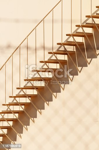 Detailed view of steel ladder, a staircase on storage reservoir at petroleum refinery. Petroleum, oil refinery and architectural details