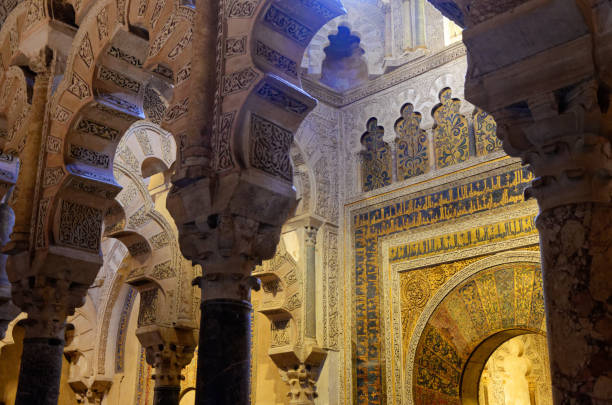 Detailed view of the arches and pillars of the mosque-cathedral of Cordoba Polylobed arches are finely engraved with quranic golden inscriptions cordoba mosque stock pictures, royalty-free photos & images