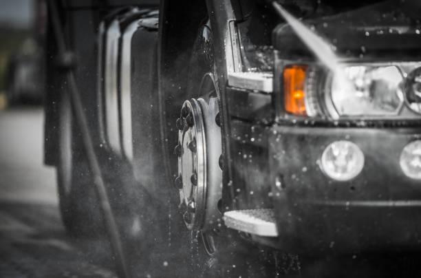 Detailed Washing Semi Truck Using Pressure Washer stock photo