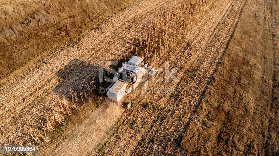 1072634078 istock photo details and aerial view of combine harvesting 1075905864