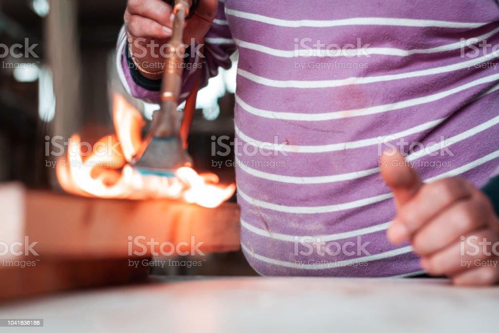 Details And Closeup Shots Of An Expert Carpenter Burning