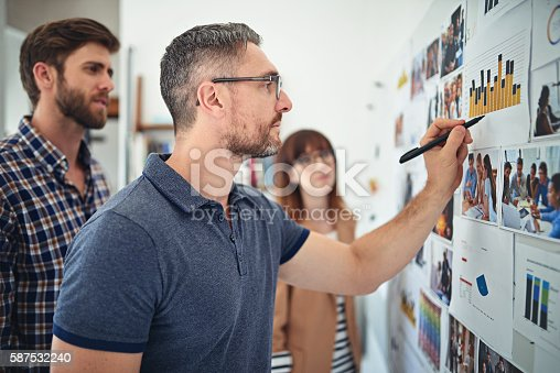 Shot of creative colleagues working together in their office