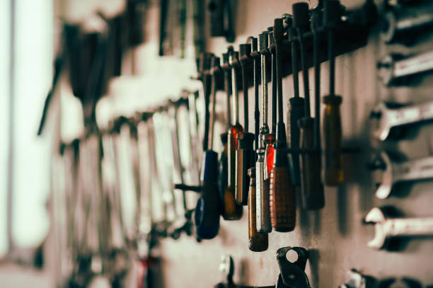 Details in the car mechanic shop - screwdrivers, spanners stock photo