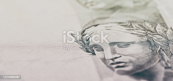 details of 100 reais banknote from brazil, with selective focus, background image for monetary concept. Financial crisis or financial business in brazil.