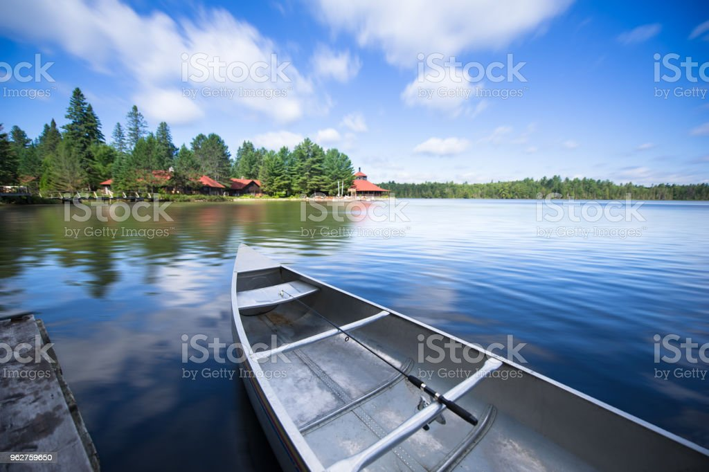 Details of a canoe tied to the dock stock photo