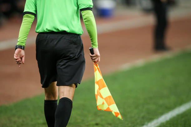 Details of a linesman referee during a soccer game Details of a linesman referee during a soccer game referee stock pictures, royalty-free photos & images
