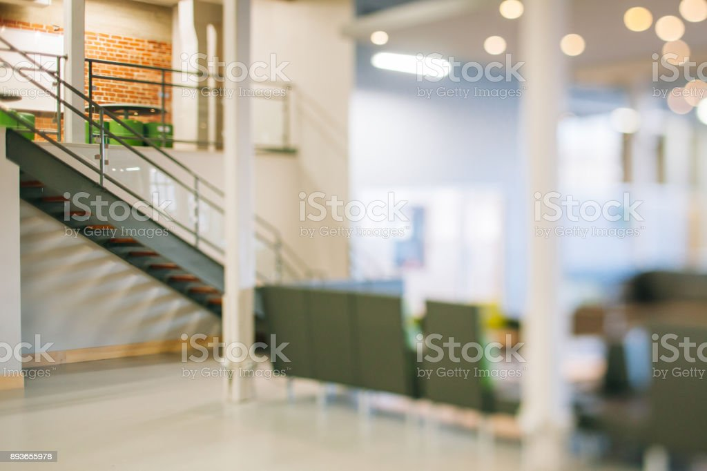 Details of a modern commercial and industrial building renovated, revamped and refurbished. New business background. Startup. Empty open plan workspace. stock photo