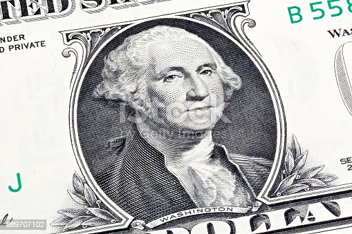 Details of a one dollar bill, George Washington in foreground. Stacked shot.
