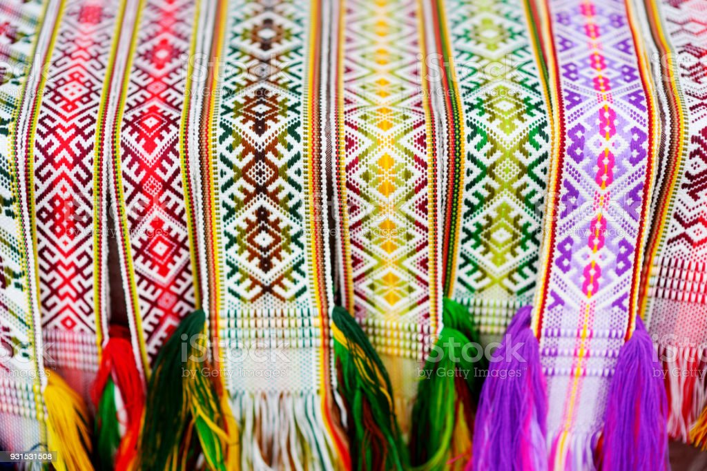 Details of a traditional colorful Lithuanian weave. Woven belts as a...