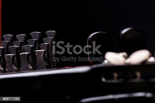 details of nyckelharpa's keys on black background