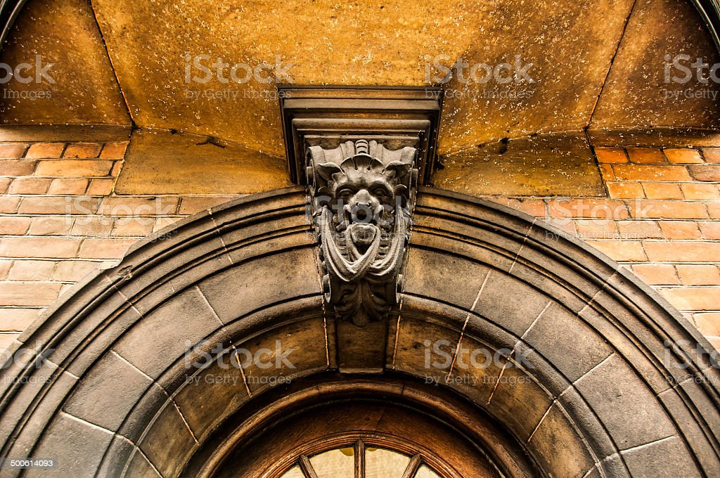 Details of arched enterance door stock photo