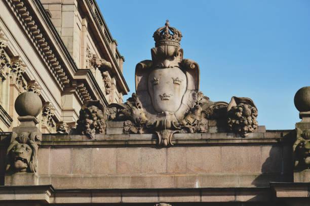 Detaljer för inredning på byggnaden av parlamentet av Sverige byggd i nyklassisk stil, med en centrerad barock Revival stil fasad avsnitt, och konst ligger på nästan hälften av Helgeandsholmen island, i det Gamla stan, gamla stan i centrala Sto bildbanksfoto