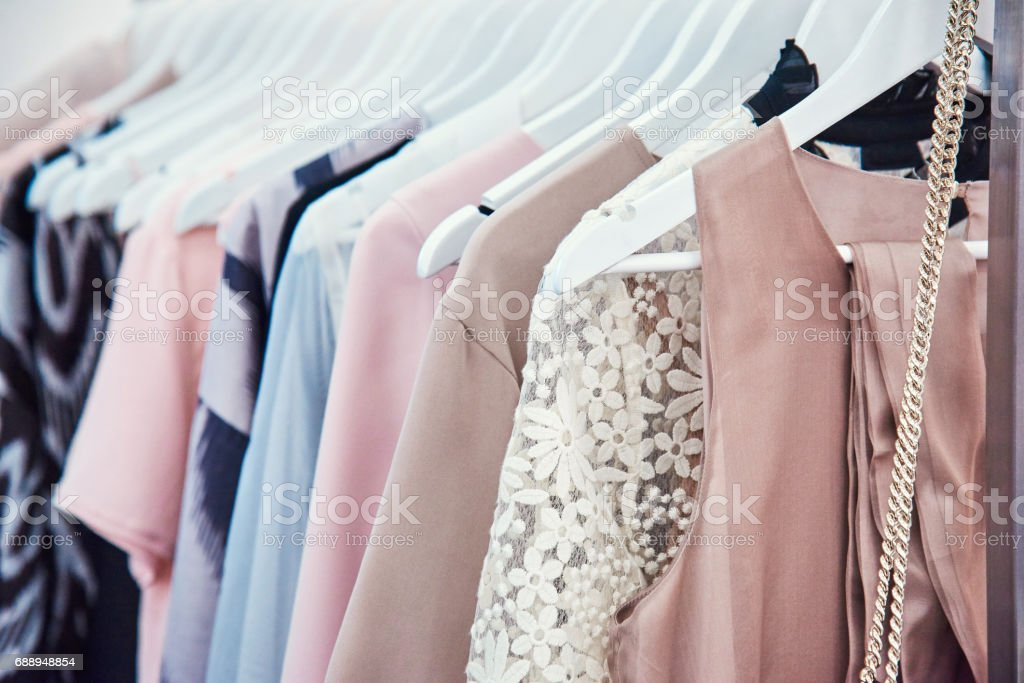 Details of bright beautiful pastel tones dress collection in show room stock photo