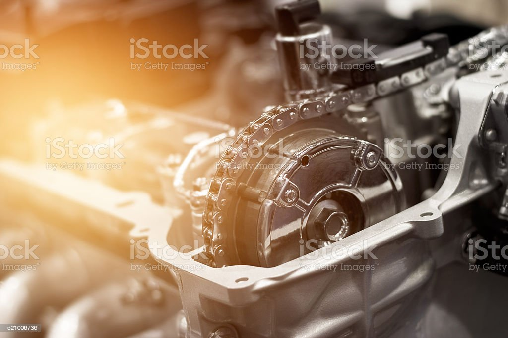 Details of car engine chain and gears, Cut away engine stock photo