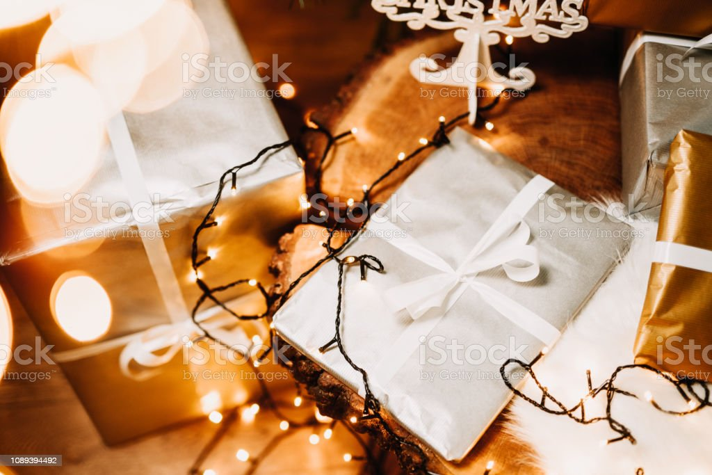 Details of christmas lights, presents, gifts and decorations in...