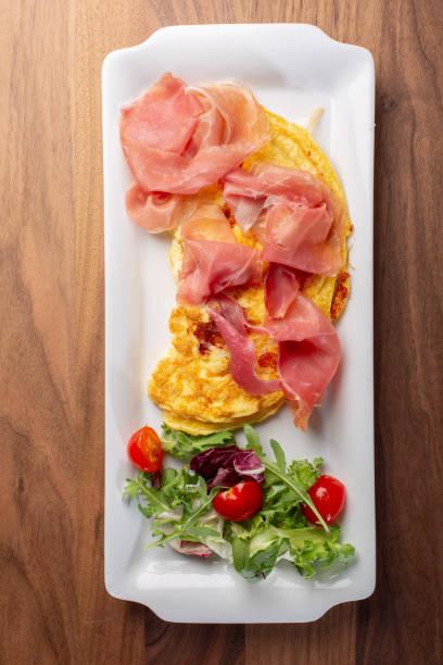 details of fresh hot omlette with ham - bresaola foto e immagini stock