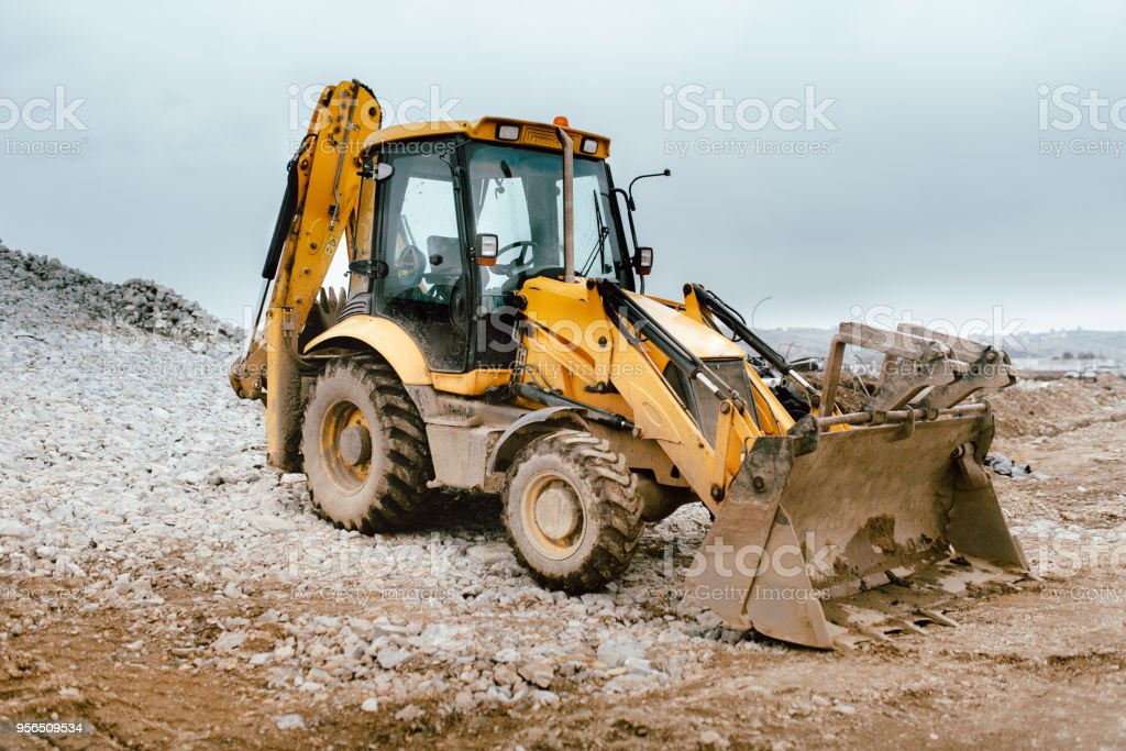 details of massive working machinery, industrial backhoe loader stock photo