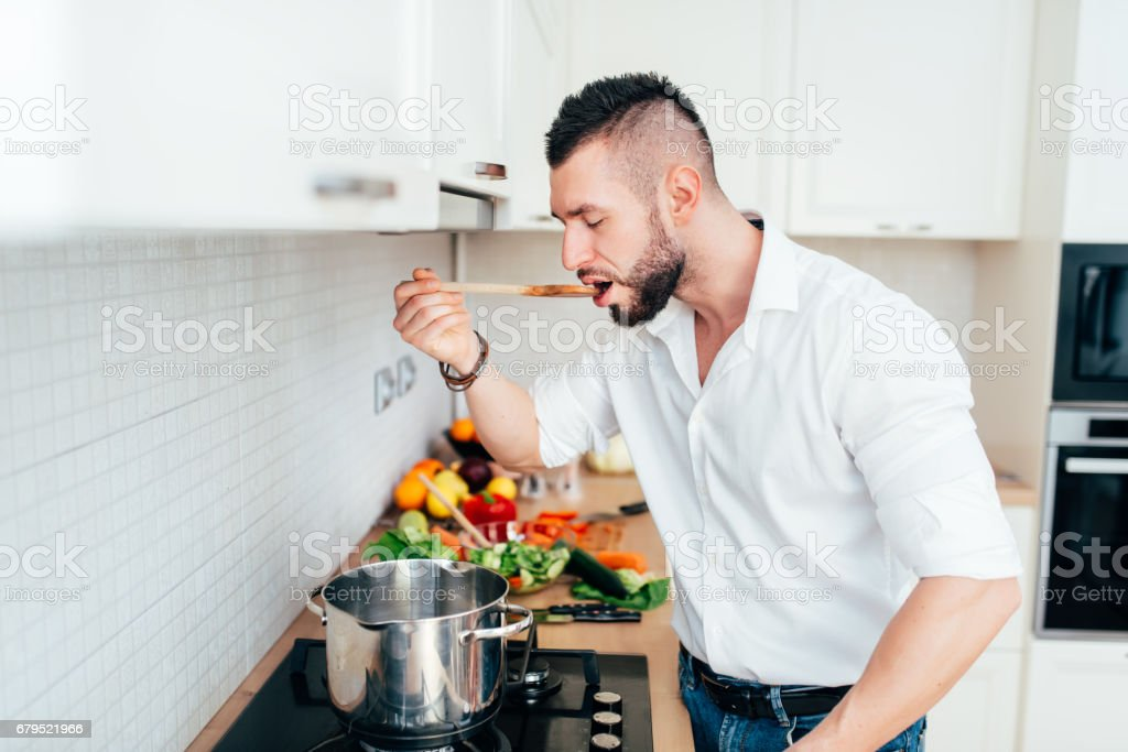 Details of modern lifestyle. Master chef tasting soup royalty-free stock photo
