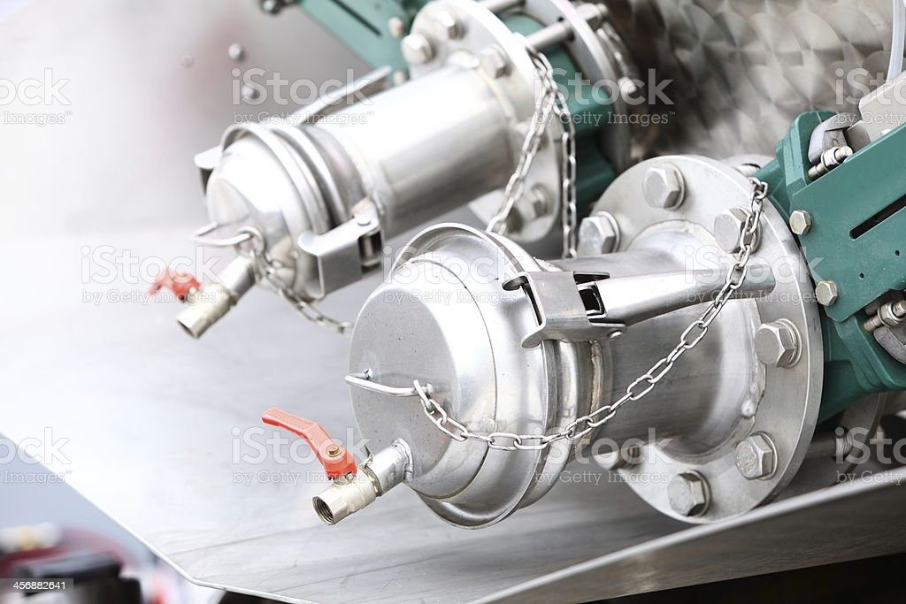 Details of new sewage truck equipment, industry valves stock photo