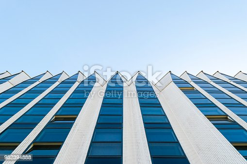 Details of office building exterior. Business buildings skyline looking up with blue sky. Modern architecture apartment. High tech exterior. Reflective buildings. Office Skyscraper. Glass office.