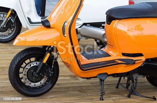 details of orange moped closeup, outdoors