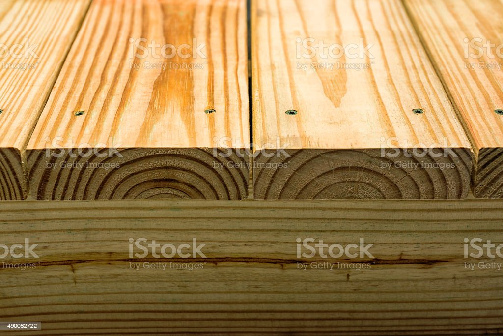 Details of the edge of newly constructed Pressure Treated deck stock photo