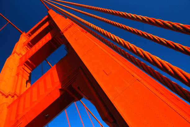 Details of the Golden Gate The orange anchor of the Golden Gate rises into the blue sky golden gate bridge stock pictures, royalty-free photos & images