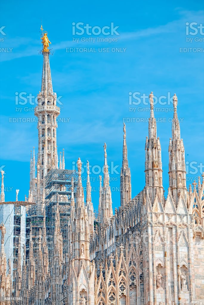 Details of the Milan Cathedral, the spiers and the Madonna stock photo