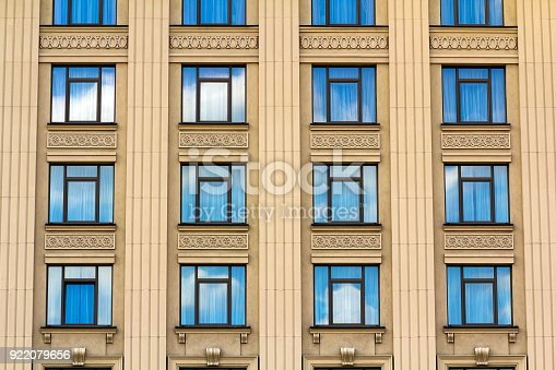 Details of windows of new constructed colorful multi-story building. Modern residential construction. Residential fund. Building of the city. New yellow house