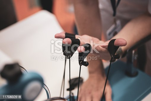950649706istockphoto Details with the hand of a woman kinetotherapy medic (physical therapist) showing finger rehabilitation therapy 1170832518