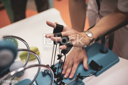 950649706istockphoto Details with the hand of a woman kinetotherapy medic (physical therapist) showing finger rehabilitation therapy 1170832520