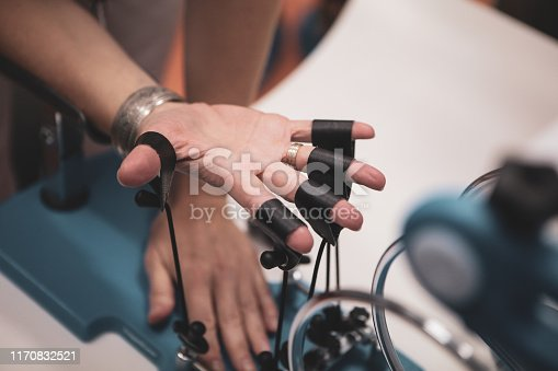 950649706istockphoto Details with the hand of a woman kinetotherapy medic (physical therapist) showing finger rehabilitation therapy 1170832521