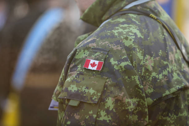 Details with the uniform and flag of Canadian soldiers Bucharest, Romania - December 1, 2018: Details with the uniform and flag of Canadian soldiers taking part at the Romanian National Day military parade. park ranger stock pictures, royalty-free photos & images
