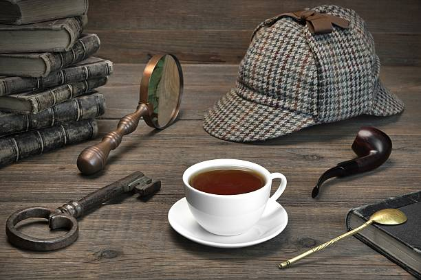 Detecrive or Investigation Concept.  Tools On The Wood Table Sherlock Holmes Concept. Private Detective Tools On The Wood Table Background. Deerstalker Cap,  Magnifier, Key, Cup, Notebook, Smoking Pipe. sherlock holmes stock pictures, royalty-free photos & images