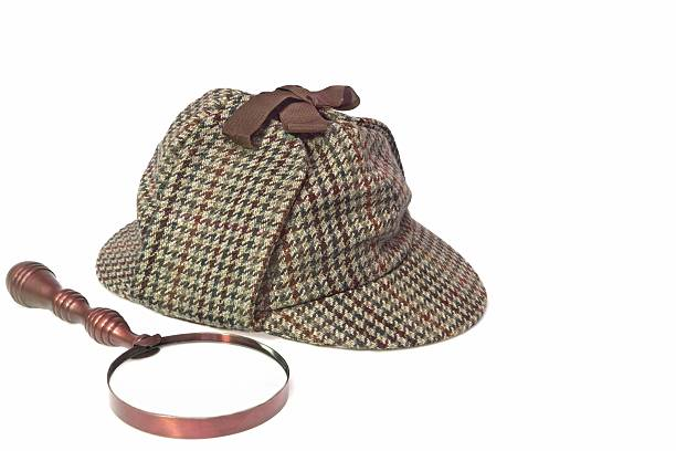 Detective Deerstalker Hat and Retro Magnifying Glass Sherlock Holmes Hat or  Deerstalker Hat and Retro Magnifying Glass Isolated on White sherlock holmes stock pictures, royalty-free photos & images