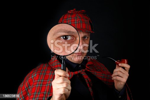 This detective is investigating with magnifying glass.